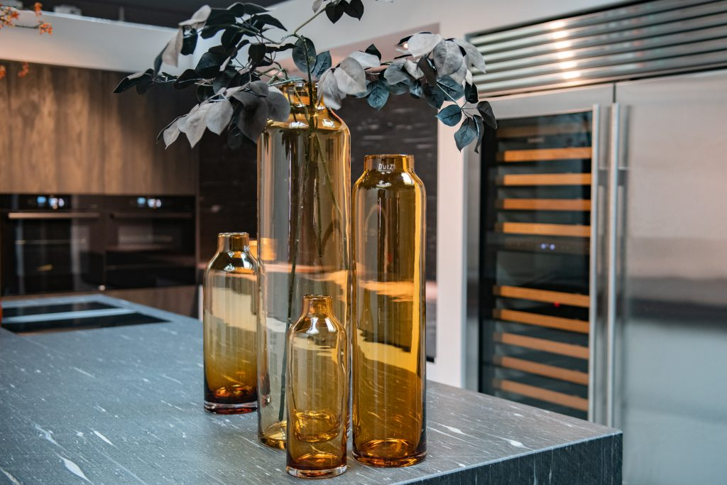Amber coloured Longo vases on a countertop