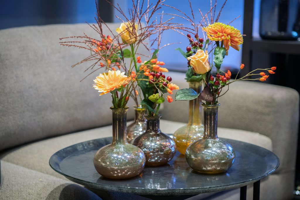 Manuela vases in the colour gold luster grouped on a grey glass plate